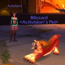 "This is a picture of a hunter from World of Warcraft with a pet they've tamed. The character is called ""Activision."" In World of Warcraft, any time you tame a pet, it becomes your property. So, it gains a tag of (So-and-so's pet) - in this case, the pet's name is Blizzard. So the entire, combined sentence reads: ""Blizzard, Activison's pet."" The suggestion is a fairly strong one."