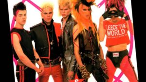 Sigue Sigue Sputnik were all about outlandish colour and left-of-centre style.  This is a shot of the band posing for the camera in their regular dress:  leather, spiky hair and colourful clothes.